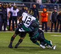Ohio's line backer Dylan Conner (No. 35) takes down Western Michigan's wide receiver Keith Mixon Jr. at Peden Stadium on Tuesday, Nov. 12, 2019.