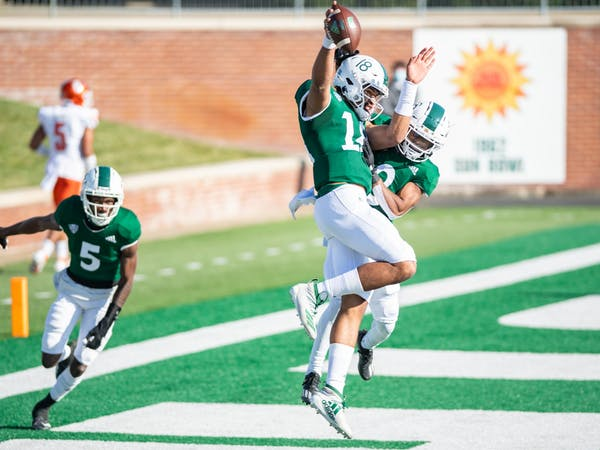 Ohio's Armani Rogers (#18) and Jerome Buckner (#8) celebrate a touchdown during Ohio's game versus Bowling Green on Saturday, Nov. 28, 2020, in Peden Stadium.