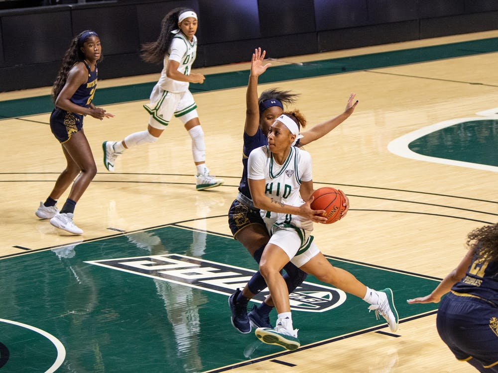Ohio's Cece Hooks (#1) drives past Notre Dame's Alasia Hayes (#5) during the Bobcats' match in The Convo on Friday, Nov. 27, 2020.