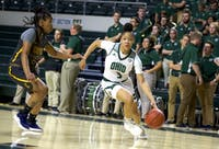Ohio guard Amani Burke drives toward the basket during the game against Coppin State on Saturday.