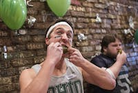 "Stuart ""Pickle Rick"" Brenkus shoves a pickle in his mouth during Pickle Fest at Bagel Street Deli on March 23, 2018. (FILE)"