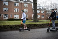 Adrew Wells  and Ryan Leonard riding the new SPIN electric scooters that arrived on campus. They were riding the scooters on East Green Drive on Feb.18th, 2020. on campus.