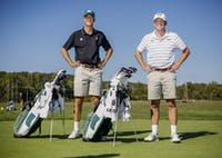 Ohio University men's golf captains Peyton White, left, and Ty Herriott, right, both seniors, pose for a portrait at the Ohio University Driving Range on West State Street on Sept. 21.