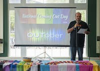 delfin bautista, the director of Ohio University's LGBT Center, gives an opening monologue during the National Coming Out Day Rally on Oct. 9, 2016, in the Bobcat Lounge in Baker Center. (FILE)