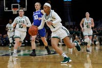 Ohio's Cece Hooks dribbles up the court during the MAC Championship Game on Saturday. (photo via Maddie Schroeder/Ohio Athletics)