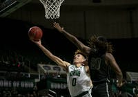 Ohio University guard, Jason Preston (#0), attempts a layup with pressure from Heidelberg Univerity's Martone Cole (#20) during the home game on Saturday, November 9, 2019.