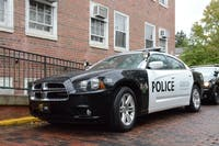 An Ohio University Police car parked outside of Scott Quadrangle. (FILE)