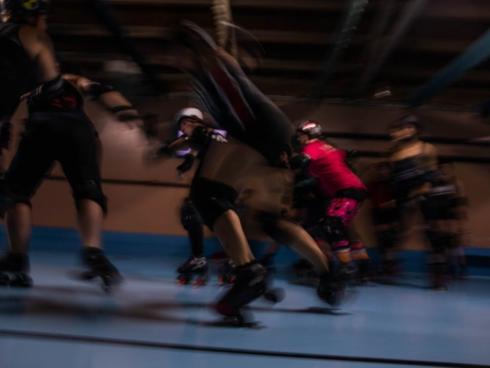 Members of the Athens Ohio Roller Derby (AORD) launch themselves for laps around the rink in a practice scrimmage held at Dow's Roller Arena on Saturday, Oct. 22, 2019.