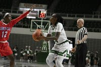 Ohio University's, Erica Johnson (#4), pulls up for a three point shot during the home game against America. (FILE)