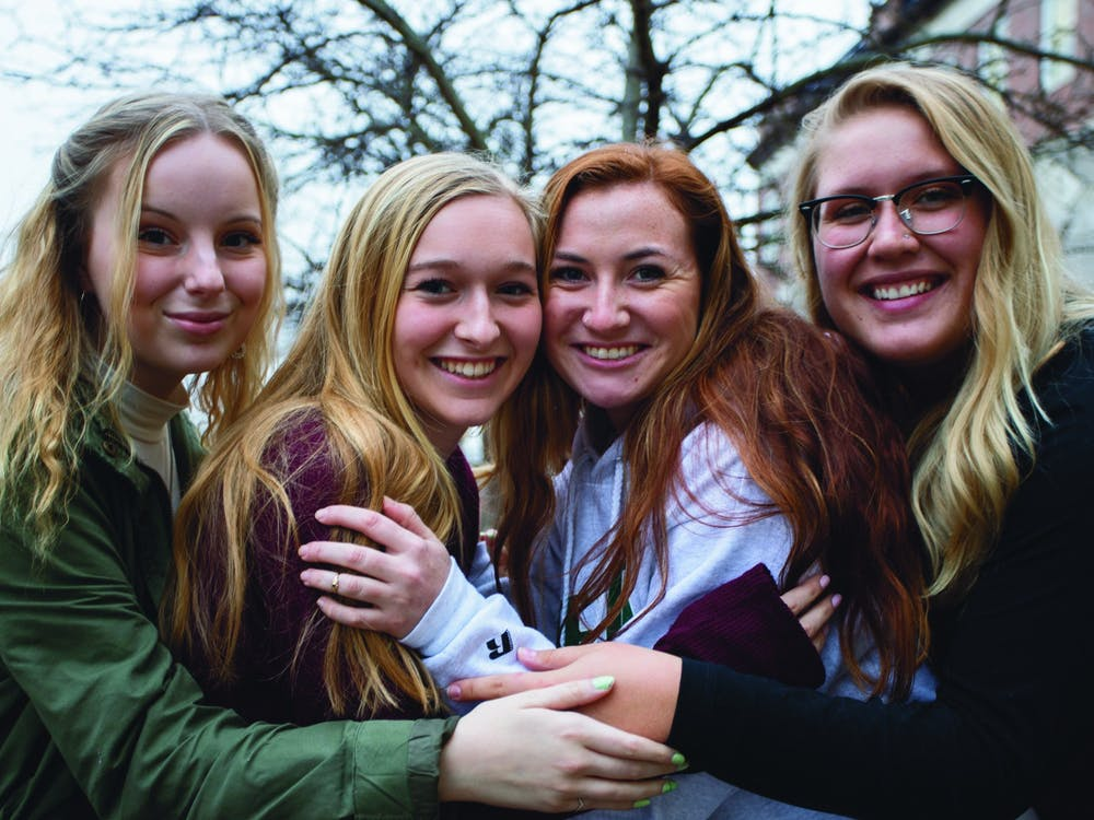 (From left to right) Leaders Alex Lenko, Mia White, Shea Shelton and Lexi Fogle of Empowered, a student organization on campus, embrace each other for a portrait on Wednesday, January 15, 2020.