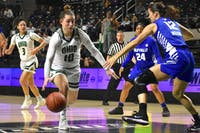 Ohio's Dominique Doseck (#10) drives past Buffalo defender Courtney Wilkins (#12) during the game against Buffalo on Wednesday.