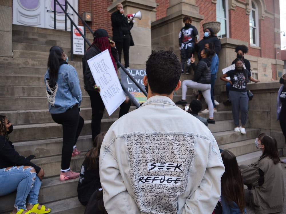 A demonstrator stands at attention during a Black Lives Matter protest organized by the NAACP at Ohio University outside the Athens Courthouse on Friday, April 23, 2021. The silent protest echoed the names of Daunte Wright and Ma'Khia Bryant, who were killed at the hands of police in recent weeks.