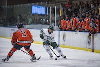 Ohio forward Tyler Harkins (#22) handles the puck during the Bobcats' game against Illinois on Saturday, Feb. 10, 2018, where they lost 4-3. (FILE)