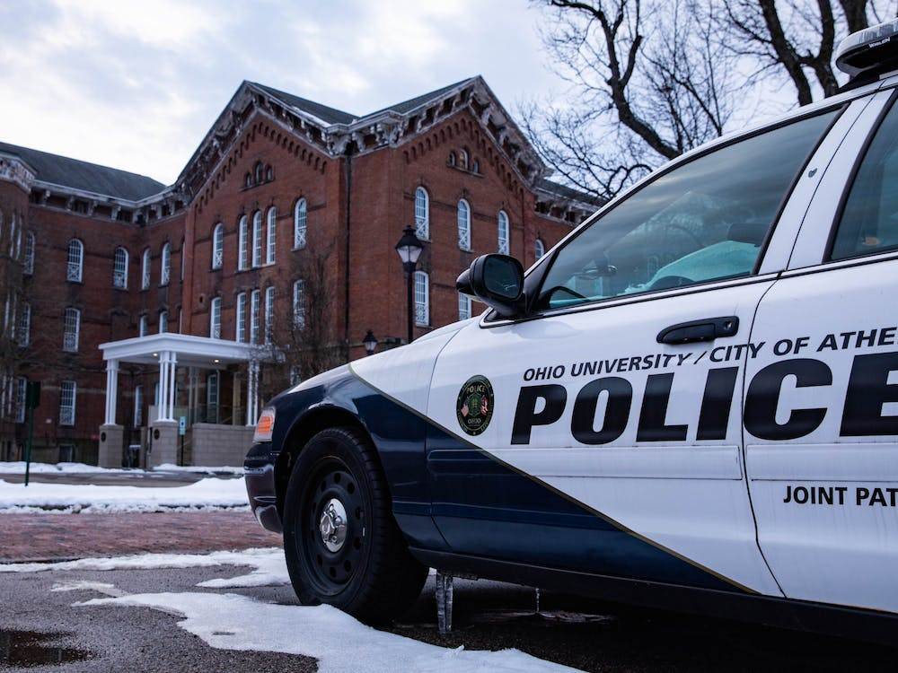 An Ohio University/City of Athens Police joint patrol car sits parked in front of the Ohio University Police Department at The Ridges on Sunday, Feb. 21, 2021.