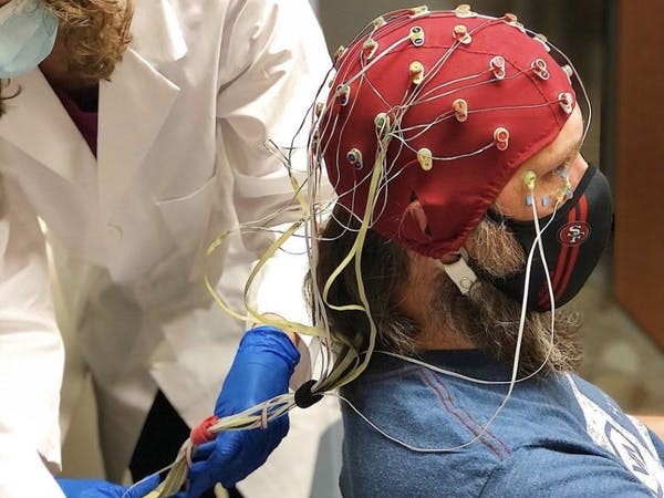 Nicholas Allan, director of the FEAR Lab and assistant professor of clinical psychology in the College of Arts and Sciences, gets suited up in EEG equipment.