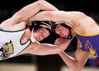 Ohio University redshirt junior Andrew Romanchik grapples with University of Northern Iowa junior Cody Caldwell. The Bobcats defeated the Panthers 20-18 at The Convo Feb. 6, 2015.