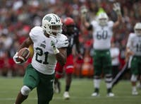 Running back Maleek Irons runs the ball into the endzone for a touchdown during Ohio's game against Cincinnati on Saturday, Sept. 22, 2018. (FILE)