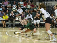 Ohio University junior Macy Reihing (No. 18) digs a ball during the Bobcat Invitational against University of Connecticut on Friday, Sept. 13, 2019. The Bobcats won in three sets.