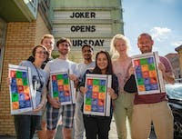 MFA film students (left to right) Tabitha Kennedy, Logan Marshall, Eddie Loupe, Anil Srivastha, Hannah Espia, Edit Jakab and Graham Holford stand in front of The Athena Cinema holding up their posters on Wednesday, Oct. 2, 2019.