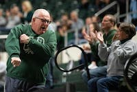 Ohio Basketball fan Norm Emmets celebrates after Ohio scores a basket during its game against Northern Illinois on Jan. 5, 2019.