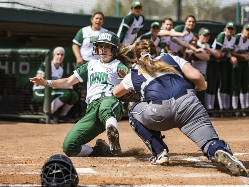 Ohio outfielder Deanna Cole (#27) attempts to slide into home plate during the Bobcats' game against Kent State on April 10. The Bobcats lost to the Golden Flashes 1-0.