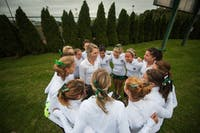 Ohio University girls cross country captain, Kayla Scott, pumps up her team before it loads onto the bus for a meet at the All-Ohio Championship in Cedarville, Ohio.