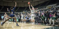 Katie Barker (2) going up for a three in a post season game against Akron in Athens, Ohio, on March 5 2018. Ohio University won 85-73, sending them to Cleveland to play Miami.