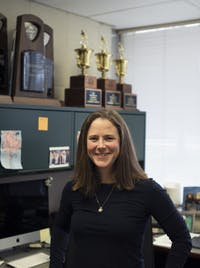 New head field hockey coach Ali Johnstone stands for a portrait in her office on Friday, March 30, 2018.