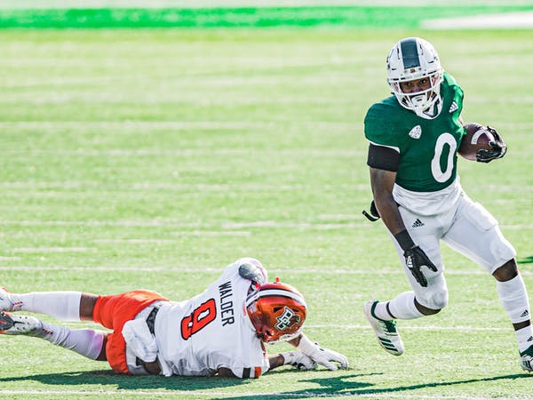 Ohio running back O'Shaan Allison (#0) avoids a tackle during Ohio's game against Bowling Green on Saturday, Nov. 28, 2020, in Peden Stadium.