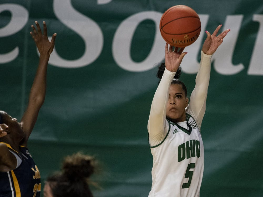 Ohio University guard, Caitlyn Kroll (5) puts up a three point shot with little defense from The University of Toledo's, Khera Goss (22), during the home game on Saturday, Jan. 9, 2021, in Athens, Ohio.