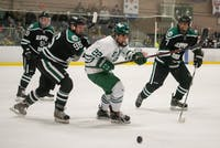 Ohio's Tyler Harkins (#22) and Slippery Rock's Nicholas Matelan (#96) and Alexander Edelberg (#7) watch the puck during the match in Bird Arena on Friday, November 15, 2019. Ohio beat Slippery Rock 10-2.