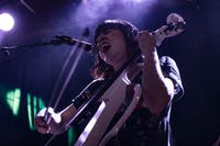 """Kate Wakefield of Cincinnati's """"Lung"""" plays electric cello and sings grungy rock originals at Casa Nueva for Benefest on Nov. 29, 2018."""