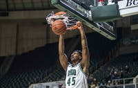 Ohio's Doug Taylor dunks the ball during the Bobcats' game against Iona on Tuesday.