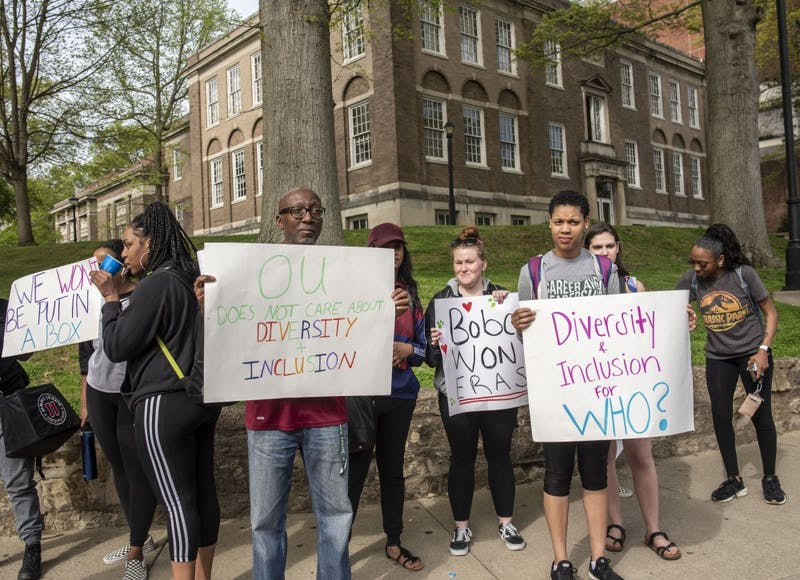 Ohio University journalism professor, Justice Hill, stands with protesters on the merging of the Multicultural Center and the LGBTQ Center.