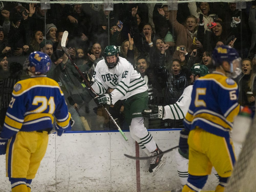 Ohio forward JT Schimizzi (12) celebrates after scoring a goal during the Bobcats hockey game on Friday, February 21, 2020, at Bird Arena in Athens, Ohio. (FILE)