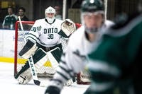 Ohio goalie Jimmy Thomas scans for the puck during the Bobcats' game against Eastern Michigan. (FILE)