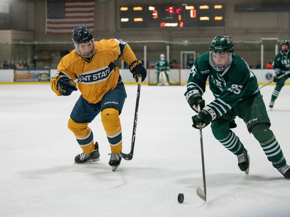 Ohio forward Drew Magyar controls the puck with pressure from Kent State defender Jake Parry during their game on Saturday, March 2, 2019, in Bird Arena.
