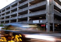 Cars drive by the City of Athens parking garage on Monday, Sept. 16, 2019.