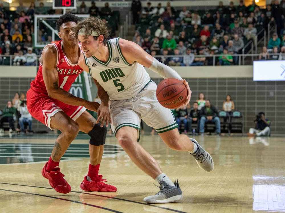 Ohio's Ben Vander Plas drives past Miami's Nike Sibande during the Ohio versus Miami match in The Convocation Center on Saturday, Feb. 8, 2020. The Bobcats won the game 77-46. (FILE)