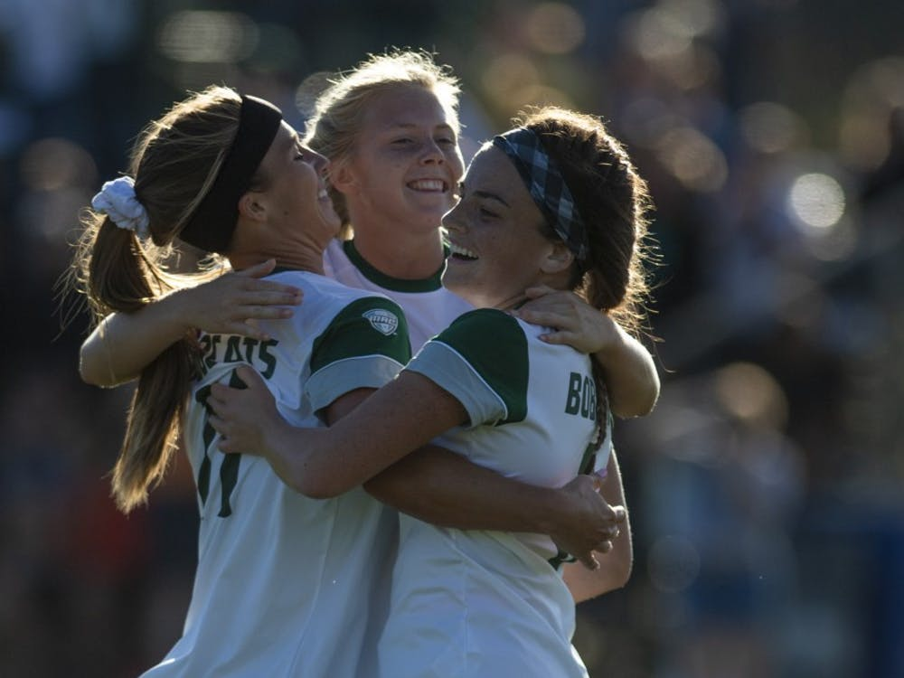 Ohio teammates Alivia Mileski, Abby Townsend and Olivia Page embrace after Page's goal in the second half of the match between the Bobcats and the Rockets at Chessa Field on Oct. 4, 2019. (FILE)