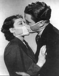 Couples during the 1918 Spanish Flu pandemic adapted to the times by kissing through surgical masks. (Photo provided via @ClaireCJS on Flickr)