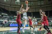 Ohio senior guard Taylor Agler (#0) goes up for a reverse layup during the Bobcats' 78-56 loss to Miami on Wednesday. (FILE)