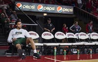 Ohio junior guard Jordan Dartis (#35) sits on the bench during a timeout after an injury during the Bobcats' 68-55 loss against Miami in the first round of the MAC Tournament on March 5.