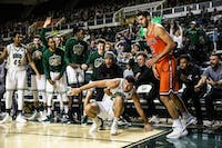 The Ohio Bobcats bench reacts after Gavin Block makes a crucial 3-pointer during the second half against Campbell on Monday.