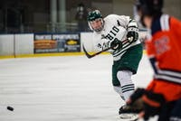 Ohio defenseman Grant Hazel (#3) shoots the puck during the Bobcats' game against Illinois on Saturday, Dec. 8 where they won 4-3 in overtime.