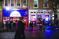 Lines to get into The Crystal and The CI nearly spill onto Court Street during the Athens Halloween Block Party on Oct. 28, 2017. (FILE)