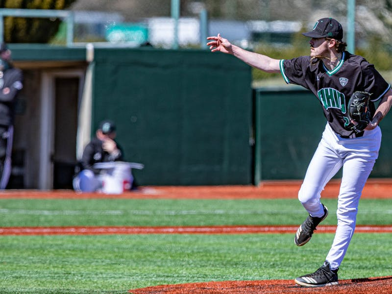 Ohio's right hand pitcher Logan Jones (#23) makes a throw against Milwaukee in the final game with a score of 3-2 on Sunday, March 7, 2021.