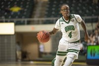 Ohio's Erica Johnson (No.4) dribbles the ball down the court at the game against the Incarnate Word Cardinals. Bobcats won 78-41 in The Convo on Saturday, Nov. 23, 2019.