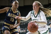 Ohio redshirt sophomore guard Katie Barker (#2) drives to the basket during the Bobcats' 85-73 win over Akron on March 5 in the first round of the MAC Tournament.
