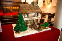 A gingerbread rendition of the The Silas Bingham House is displayed at the Southeast Ohio Historic Center for The Southeast Ohio Gingerbread House Display and Competition. The house was created by Nancy Mingus and Jennifer Dillie and won the grand prize in the professional category.
